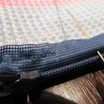 Sewing The Zipper To A Crochet Pouch